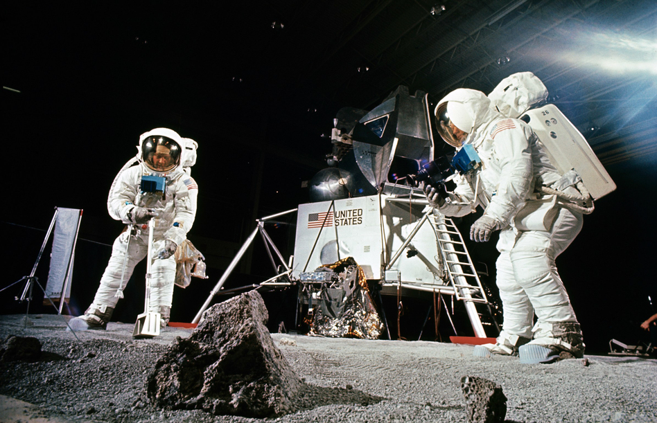 Buzz Aldrin (left) practices collecting a sample while Neil Armstrong photographs during a training session before the Apollo 11 mission. The Apollo 11 astronauts returned with about 50 pounds of material, including 50 rocks. (NASA)
