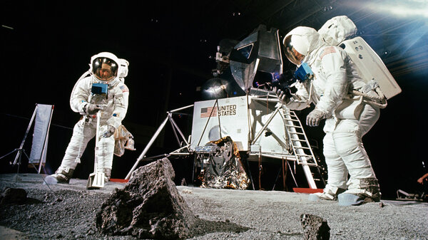 Buzz Aldrin (left) practices collecting a sample while Neil Armstrong photographs during a training session before the Apollo 11 mission. The Apollo 11 astronauts returned with about 50 pounds of material, including 50 rocks.