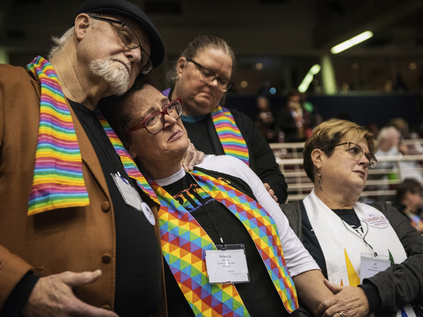 Ed Rowe (from left), Rebecca Wilson, Robin Hager and Jill Zundel react to the defeat of a proposal that would have allowed LGBTQ clergy and same-sex marriage within the United Methodist Church, at the denomination's Special Session of the General Conference in February.