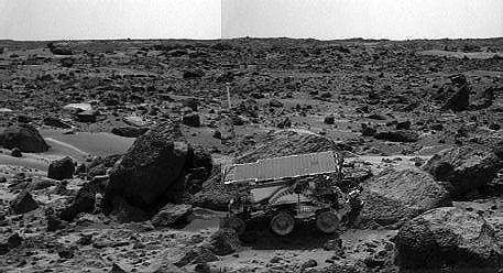 "The Sojourner rover's Alpha Proton X-ray Spectrometer (APXS) is shown deployed against the rock ""Moe"" on Sol 64."
