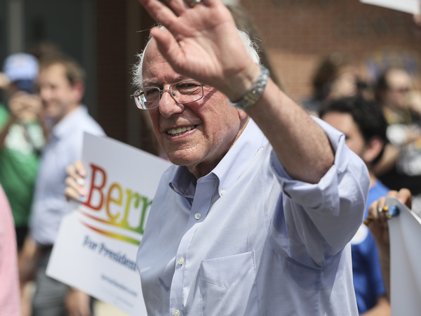 Democratic presidential candidate Sen. Bernie Sanders, I-Vt., waves as he marches with supporters in the Nashua Pride Parade in Nashua, N.H. on June 29, 2019.