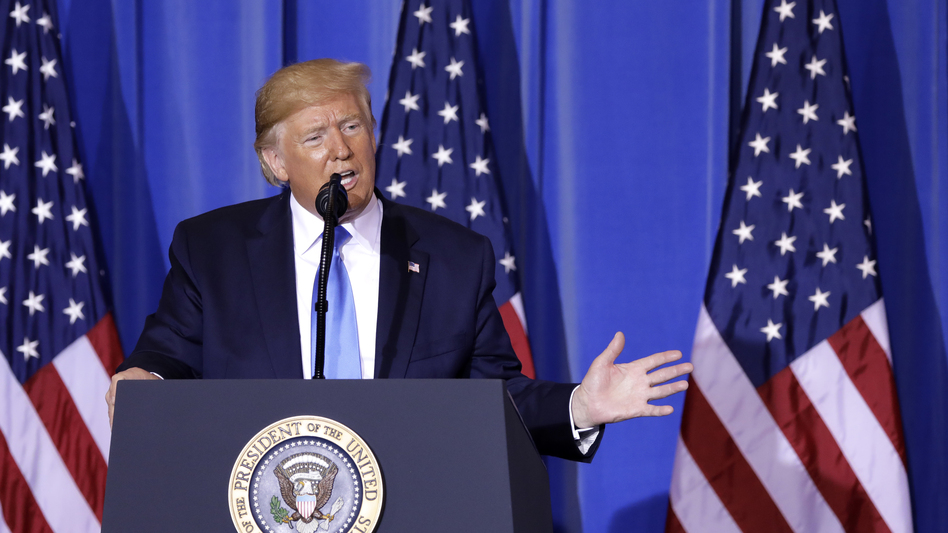 President Trump speaks during a news conference following the Group of 20 summit in Osaka, Japan, on Saturday. Trump said the U.S. and China would resume trade talks. (Kiyoshi Ota/Bloomberg via Getty Images)