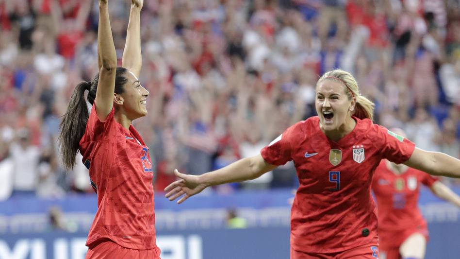Christen Press (left) celebrates after scoring the U.S.'s first goal during the Women's World Cup semifinal against England. The U.S. won 2-1. (Alessandra Tarantino/AP)