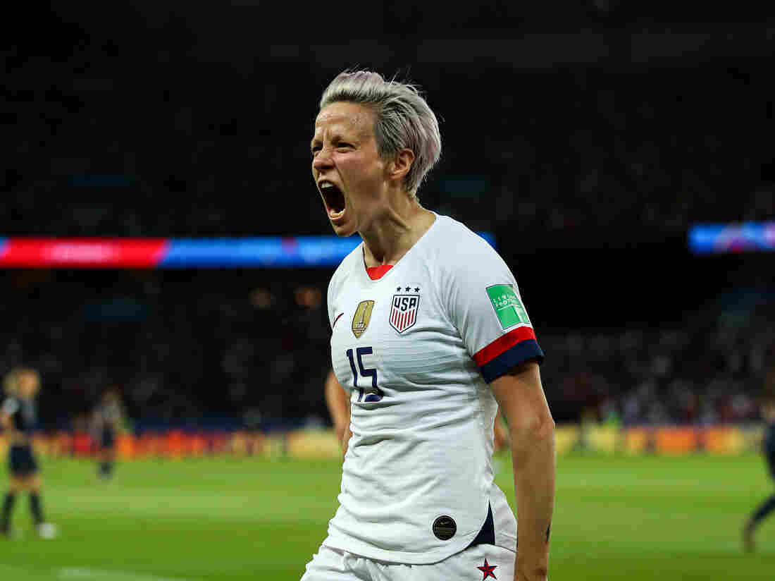 United States star Megan Rapinoe watches semifinal from sidelines