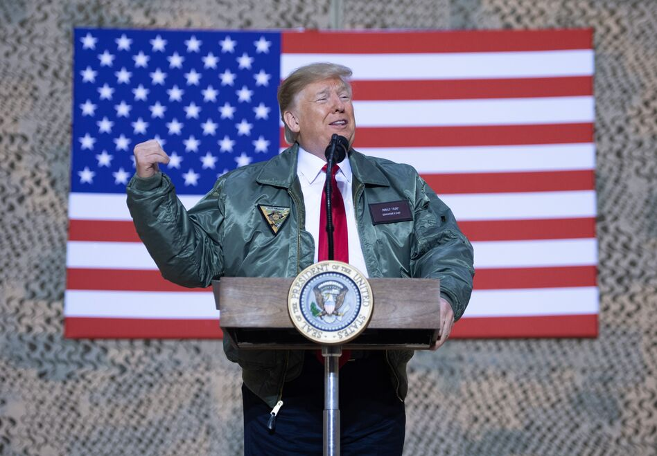 President Trump speaks to members of the U.S. military during an unannounced trip to Al Asad Air Base in Iraq on Dec. 26, 2018. (Saul Loeb/AFP/Getty Images)