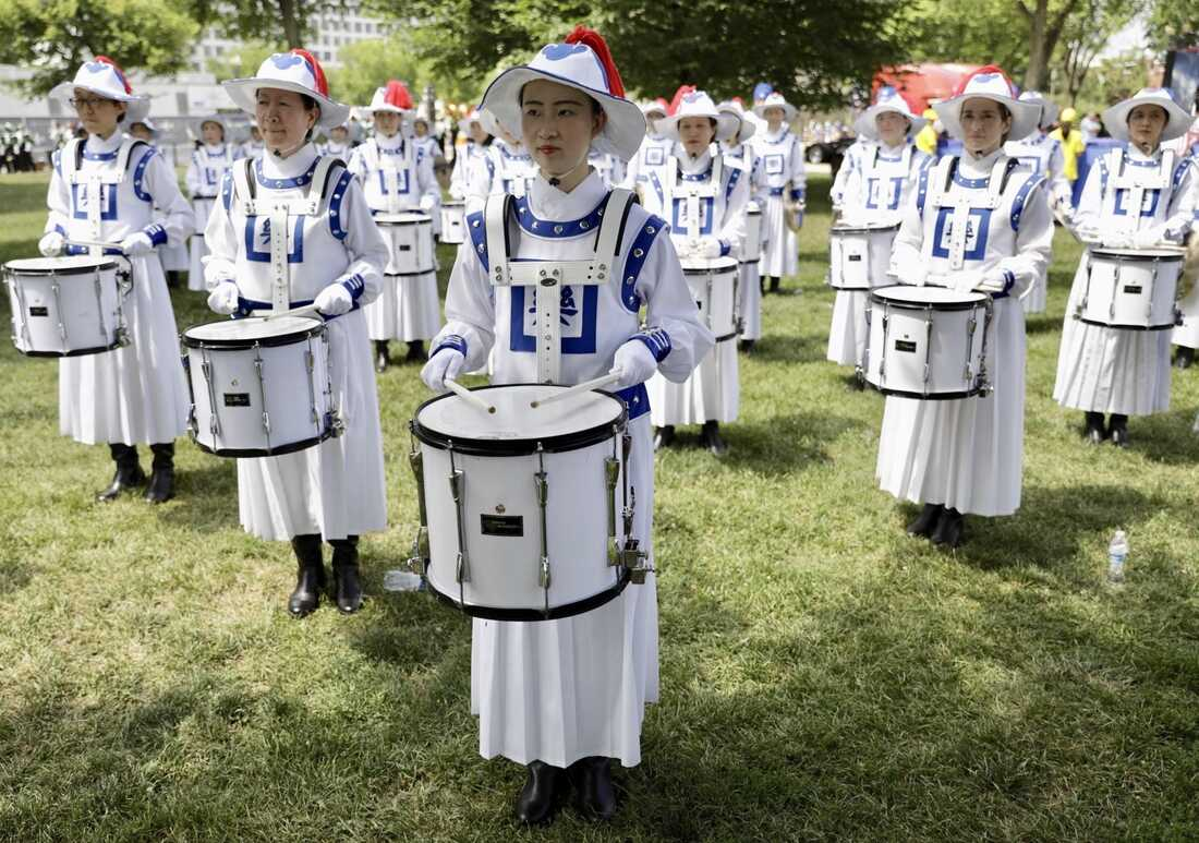 Drummers stand in formation on the grass as part of the National Independence Day Parade festivities in Washington, D.C.
