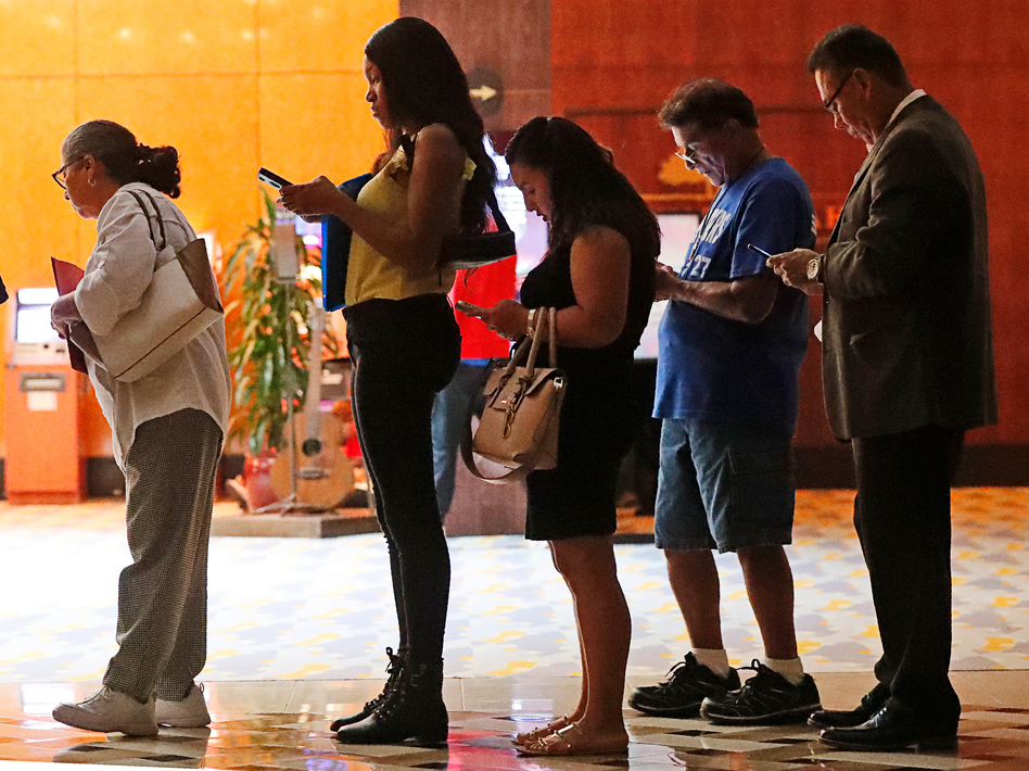 Job applicants wait in line at the Seminole Hard Rock Hotel & Casino Hollywood during a job fair in Hollywood, Fla., on Thursday. (Wilfredo Lee/AP)