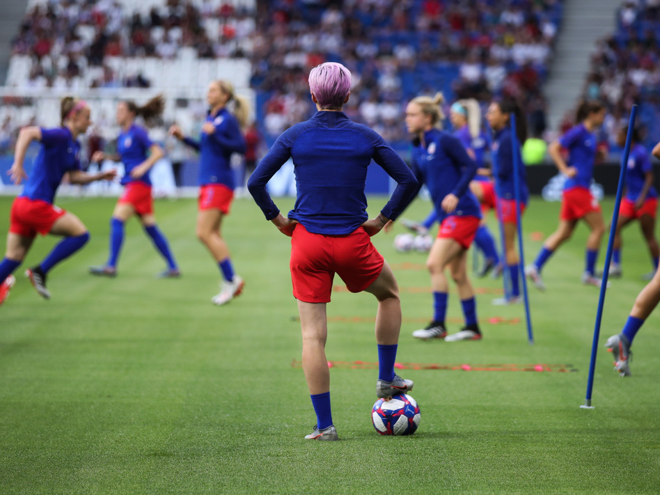 The Netherlands are the last team standing between the United States and its fourth Women's World Cup. Here, U.S. forward Megan Rapinoe watches her teammates warm up before Tuesday's 2-1 semifinal win over England. (Alex Grimm/Getty Images)