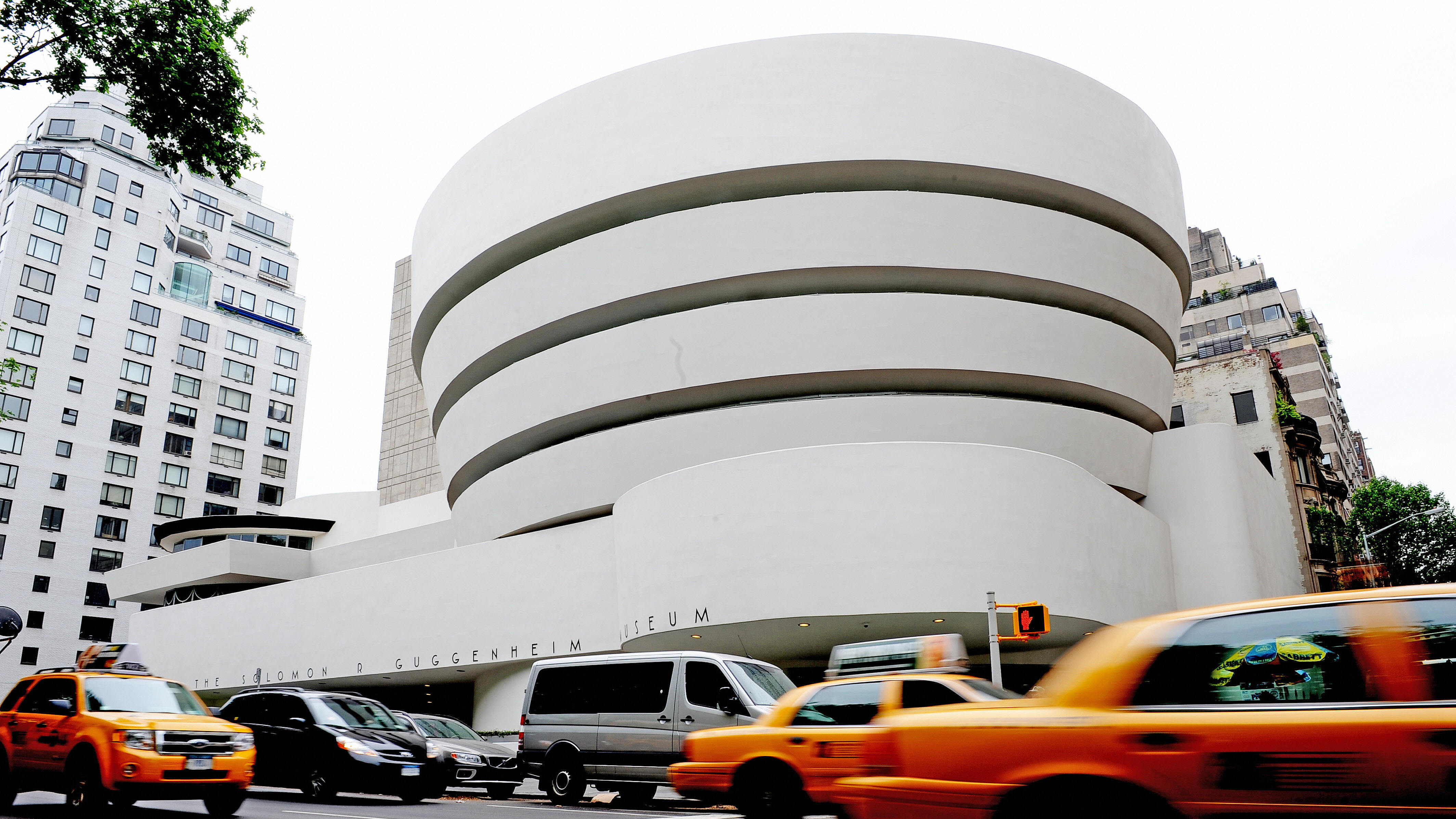 "The Guggenheim Museum, designed by Frank Lloyd Wright who developed the concept of ""organic architecture,"" that a building should develop out of its surroundings."