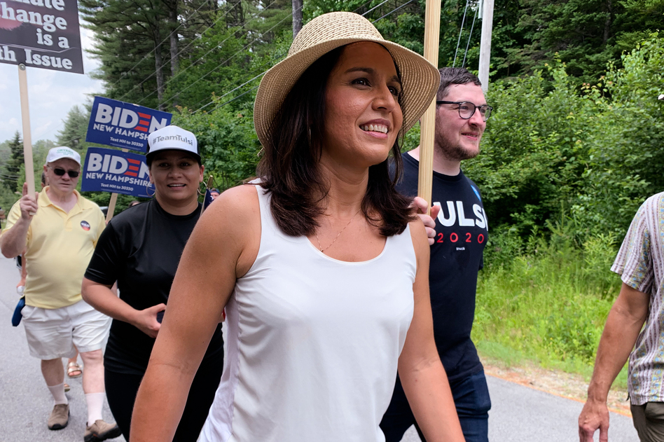 """Hawaii Rep. Tulsi Gabbard, seen in Franconia, N.H., on July 6, is one of nearly two dozen Democrats running for president. A major in the Hawaii Army National Guard, she served two tours of duty in the Middle East and says that the experience informed her concern about """"wasteful regime change wars."""" (Tamara Keith/NPR)"""