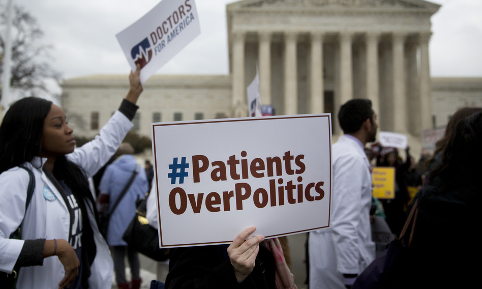Demonstrators from Doctors for America marched in support of the Affordable Care Act outside the U.S. Supreme Court in March 2015. Now, another case aims to undo the federal health law: <em>Texas v. United States</em> could land in front of the Supreme Court ahead of the 2020 election. (Andrew Harrer/Bloomberg via Getty Images)