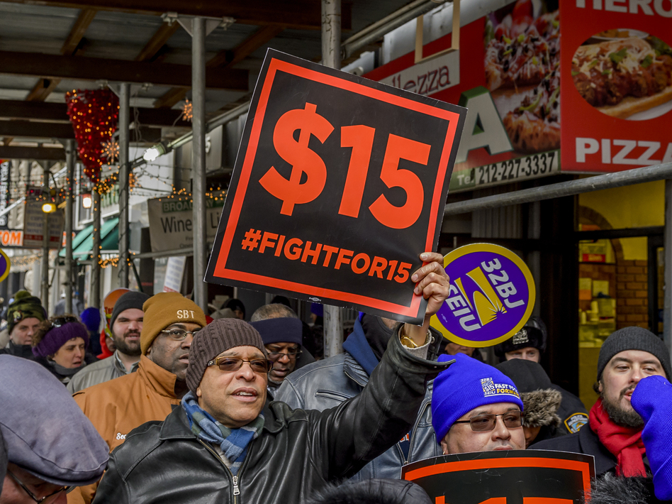 People protest for a $15 minimum wage in New York City in 2017. (Pacific Press/LightRocket via Getty Images)
