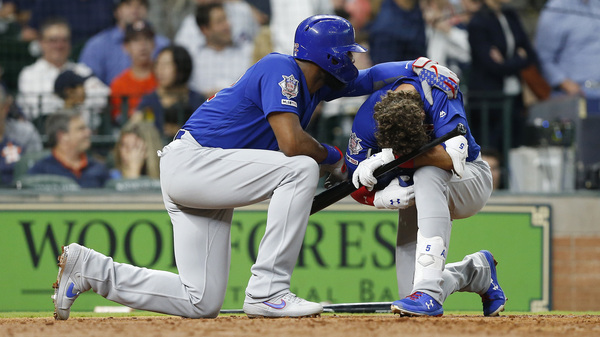 Albert Almora Jr. of the Chicago Cubs is comforted by Jason Heyward after a young child was injured by a foul ball off Almora