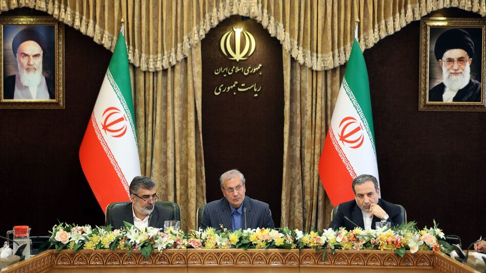 From left: Iran's Atomic Energy Organization spokesman Behrouz Kamalvandi, government spokesman Ali Rabiei and Deputy Foreign Minister Abbas Araghchi give a joint press conference at the presidential headquarters in the capital Tehran on Sunday. Iran is enriching uranium beyond a 3.67% cap set by the nuclear deal. (Hamed Malekpour/AFP/Getty Images)
