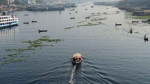 Bangladeshi commuters use boats to cross the Buriganga River in the capital Dhaka in 2018. In July, Bangladesh