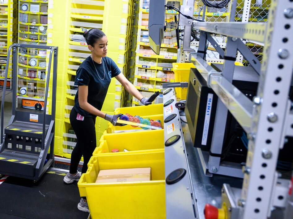 Amazon said it will invest $700 million to train 100,000 employees for higher-skilled jobs by 2025. Training programs will be offered to workers throughout all levels of the company. (Johannes Eisele/AFP/Getty Images)