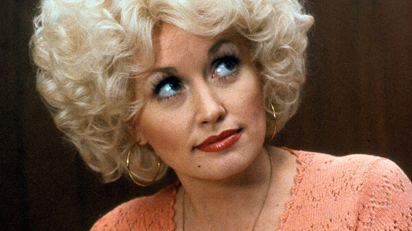 Dolly Parton in a scene from the 1980 comedy 9 to 5. The film's theme song, performed by Parton, took on a life of its own.