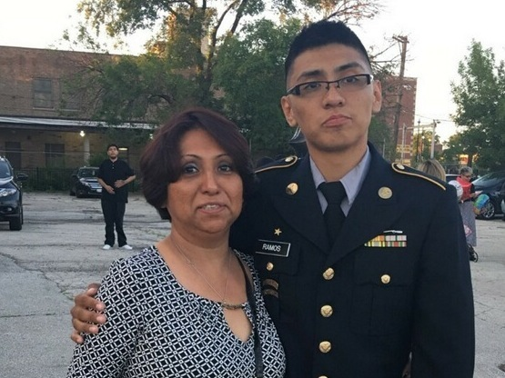 Lewis Ramos, 22, an operations specialist in the U.S. Army National Guard, stands with his mother, Rosa Elena Ramos, who arrived illegally 30 years ago from Mexico. He recently learned she would receive the protection by the time he leaves later this month.