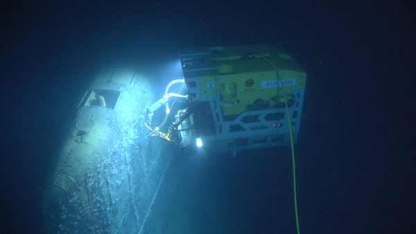 A remote submersible surveys the wreck of the Komsomolets, roughly a mile beneath the surface of the Norwegian Sea.