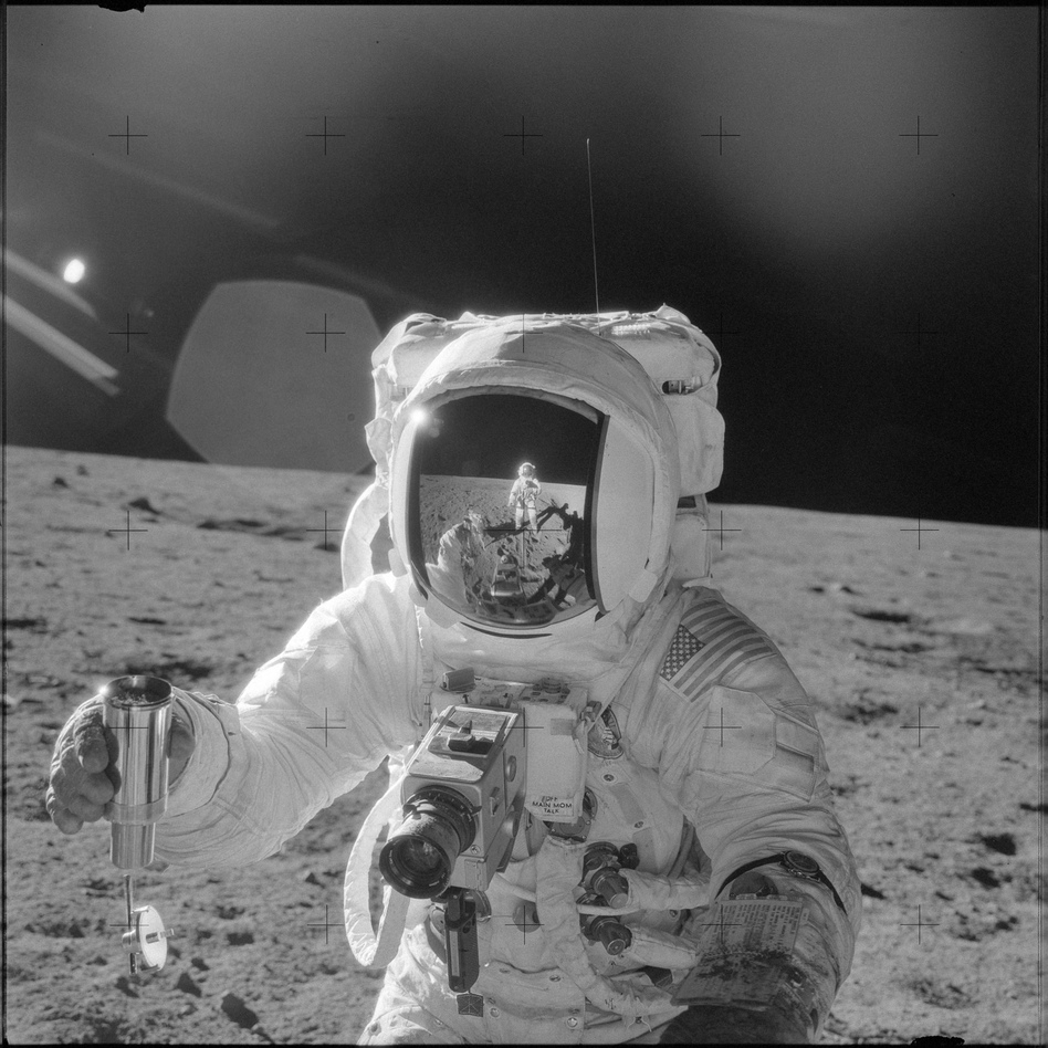 Astronaut Alan L. Bean holds a container filled with lunar soil collected during the extravehicular activity in which astronauts Charles Conrad Jr., commander, and Bean, lunar module pilot, participated. (Charles Conrad Jr./NASA)