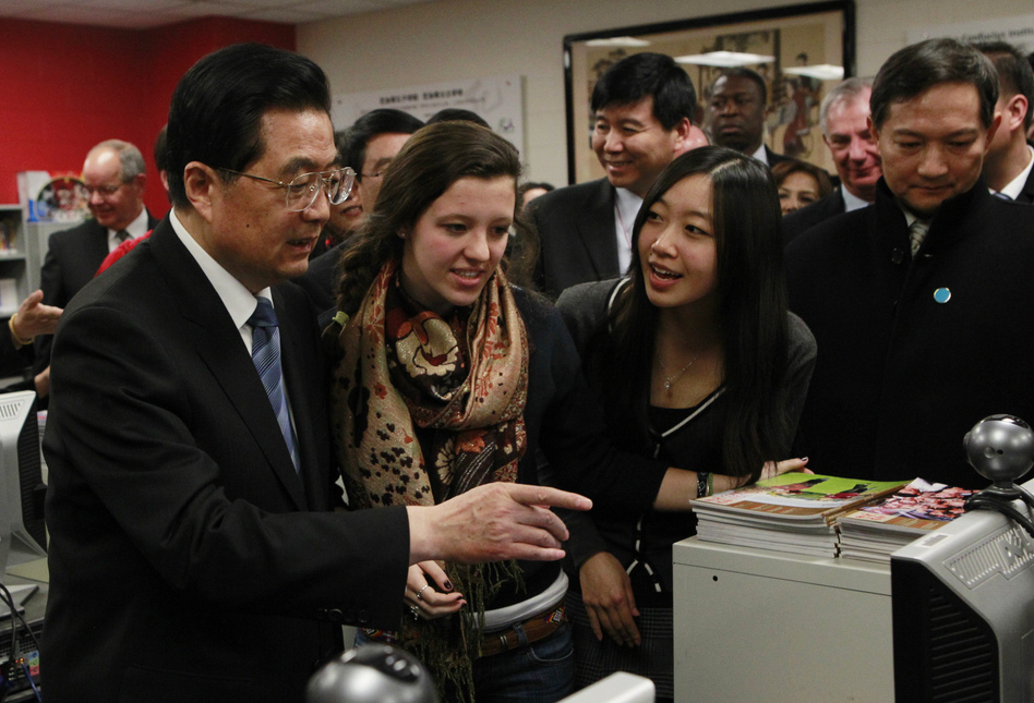 In this 2011 photo, Hu Jintao, then China's president, visits the Confucius Institute at the Walter Payton College Preparatory High School in Chicago. China established more than 100 Confucius Institutes, which provide language and culture programs, at U.S. schools. But at least 13 universities have dropped the program due to a law that raises concerns about Chinese spying. (Chris Walker/AP)