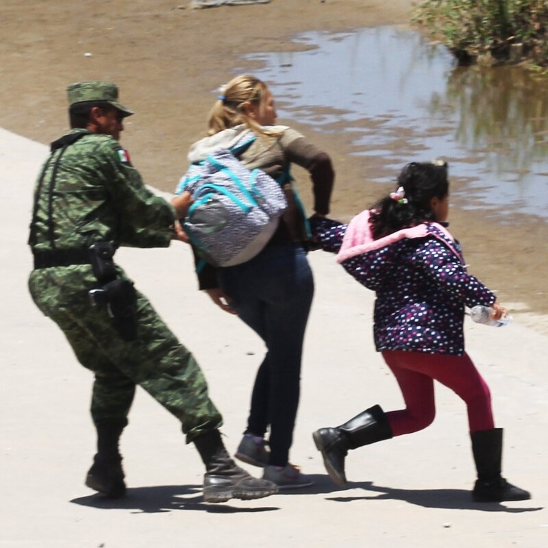 Photo Of Mother Pleading With Mexican Soldier Draws