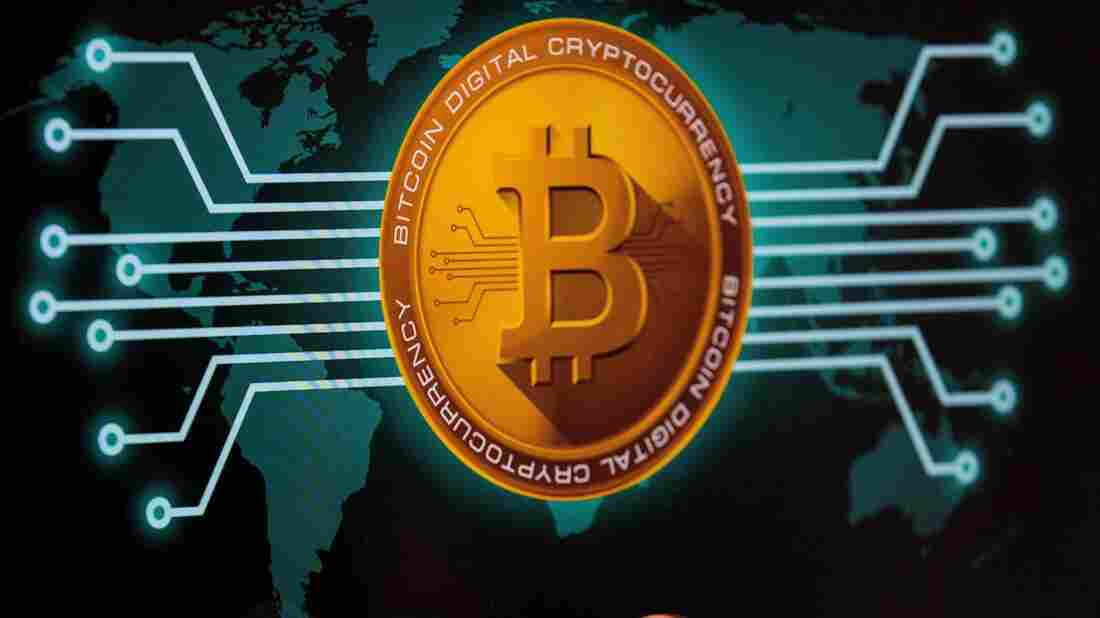 """A picture taken on February 6, 2018 shows a visual representation of the digital crypto-currency Bitcoin, at the """"Bitcoin Change"""" shop in the Israeli city of Tel Aviv."""