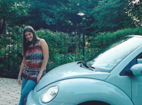 Kristine Smith, pictured in 2005, when she first got her robin egg blue convertible Beetle for her 16th birthday.