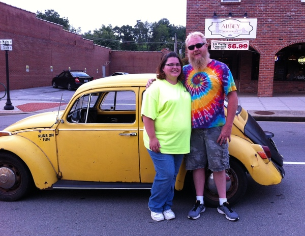 """Jessica Bray and her husband, Anthony Bray, pose with their 1970 Volkswagen Beetle. Anthony converted his Beetle to an electric car. """"As a special touch, we added bubble machines to the back to blow bubbles at car shows and as we drive,"""" Jessica said."""