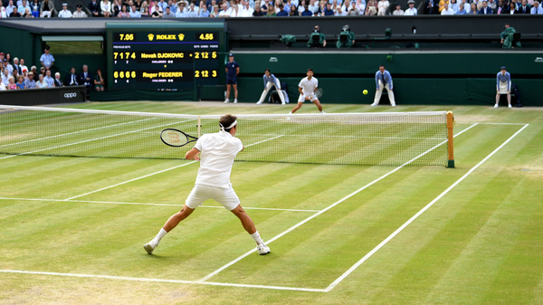 Roger Federer of Switzerland plays a forehand against Novak Djokovic of Serbia during the 2019 Wimbledon men