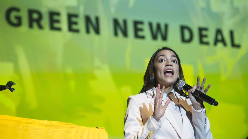 """Rep. Alexandria Ocasio-Cortez speaks about the Green New Deal in Washington, D.C., on May 13. She has shined a spotlight on a once-obscure brand of economics known as """"modern monetary theory."""" (Cliff Owen/AP)"""