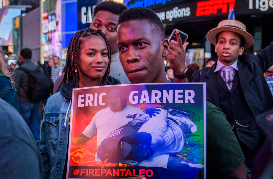 Members of Black Lives Matter of Greater New York and allies hold a protest rally last month in New York City's Times Square demanding justice for Eric Garner, who died after he was put in a chokehold by an NYPD officer in 2014. (Erik McGregor/Pacific Press/LightRocket via Getty Images)