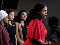 "From Right: U.S. Reps. Ayanna Pressley, Rashida Tlaib, Alexandria Ocasio-Cortez and Ilhan Omar at a press conference at the Capitol on Monday. President Trump has accused the ""squad"" of hating America and has said they should ""go back"" to where they came from."
