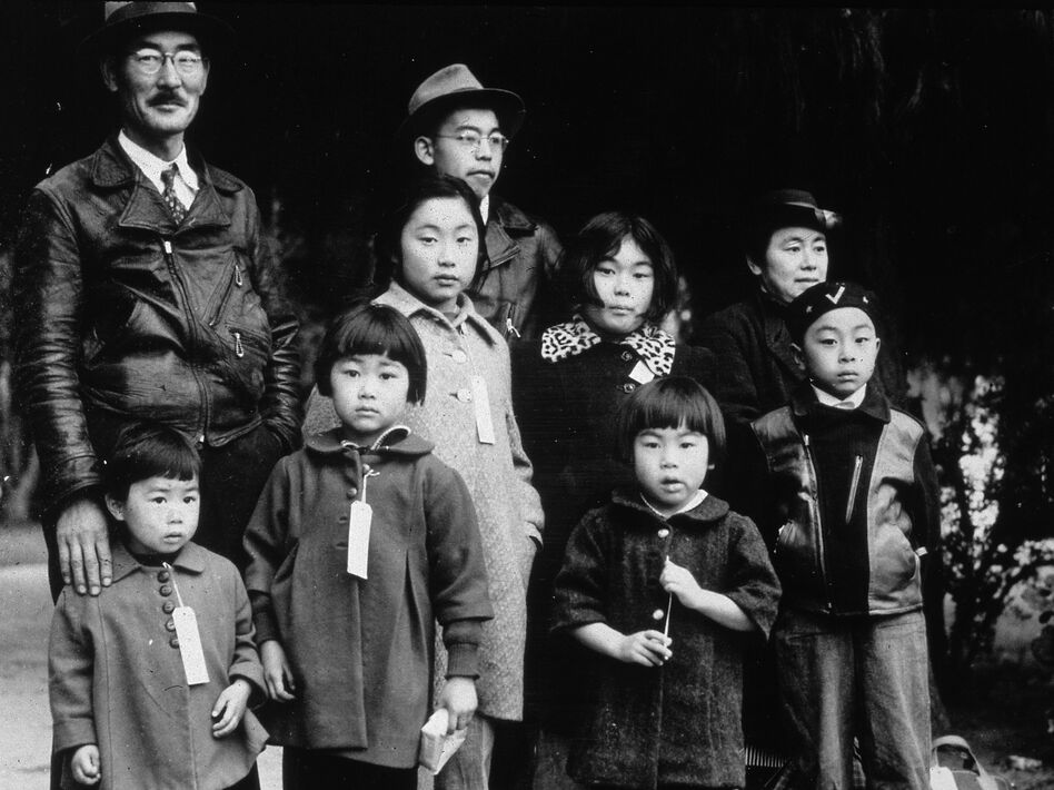 Members of the Japanese American Mochida family, in Hayward, Calif., await relocation to an incarceration camp during World War II. (Dorothea Lange/Getty Images)
