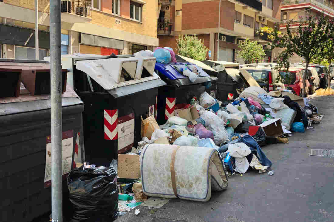 Westlake Legal Group img_5738_slide-6d1b8a07b3267ff462432dc3b810cb60a9e75812-s1100-c15 In Rome, Uncollected Trash Festers In Scorching Heat