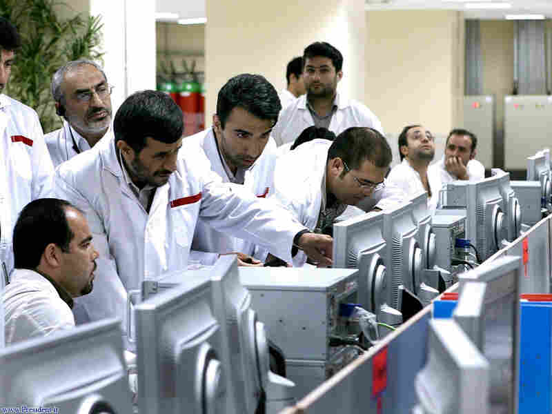 Iranian President Mahmoud Ahmadinejad, left, points as he talks to a technician during his visit of the Natanz uranium enrichment facility some 200 miles (322 kilometers) south of the capital Tehran, Iran, on April 8, 2008.