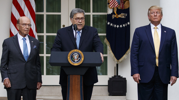 Attorney General William Barr speaks as he stands with President Donald Trump and Commerce Secretary Wilbur Ross during an event about the census in the Rose Garden at the White House earlier this month.