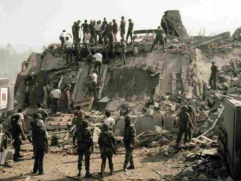 Rescue workers remove the body of a U.S. Marine from the rubble of the Marine Battalion headquarters at Beirut airport, Oct. 23, 1983. The building was destroyed by a truck loaded with explosives.