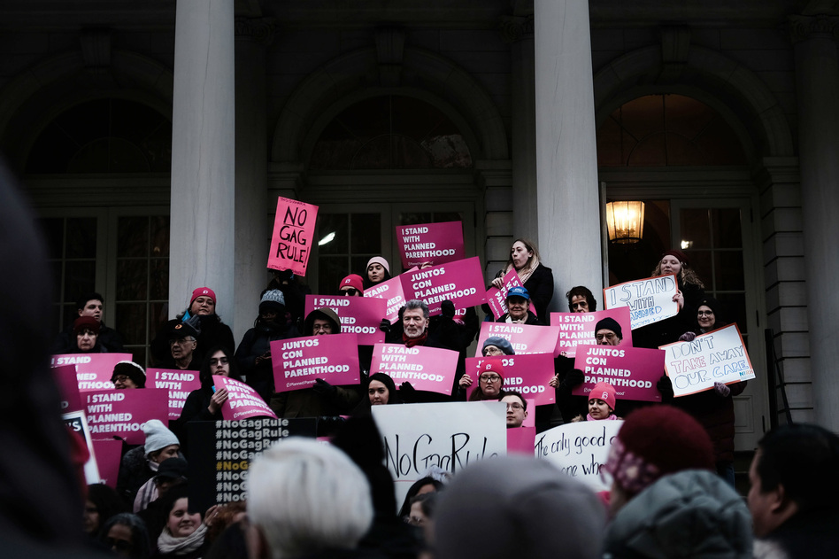 Supporters of Planned Parenthood demonstrated at New York's City Hall against the Trump administration's Title X rule change in February. Planned Parenthood now says it clinics nationwide will stop using federal Title X family planning funds. (Spencer Platt/Getty Images)