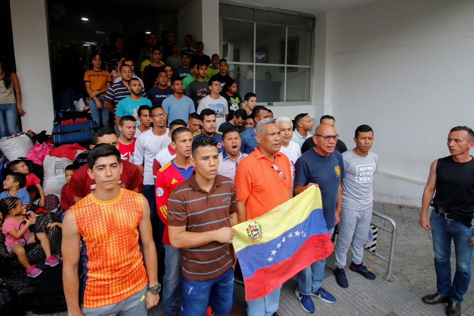 Venezuelan soldiers and policemen who deserted to Colombia protest after being evicted from the hotel where they were staying in Cúcuta in May. More than 1,400 members of Venezuelan security forces fled the country in February and March. (Schneyder Mendoza/AFP/Getty Images)