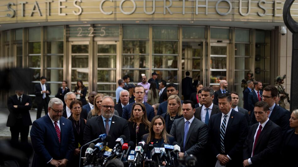 """Joaquin Guzmán, also known as """"El Chapo,"""" was sentenced Wednesday to a life term in prison plus 30 years. After the sentencing in a Brooklyn courthouse, U.S. attorneys and other officials greeted the media, including Ariana Fajardo Orshan, U.S. attorney for the Southern District of Florida. (Johannes Eisele/AFP/Getty Images)"""