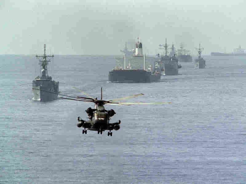 A US Navy minesweeping helicopter leads the way for the US reflagged Kuwaiti tanker convoy on October 22, 1987.