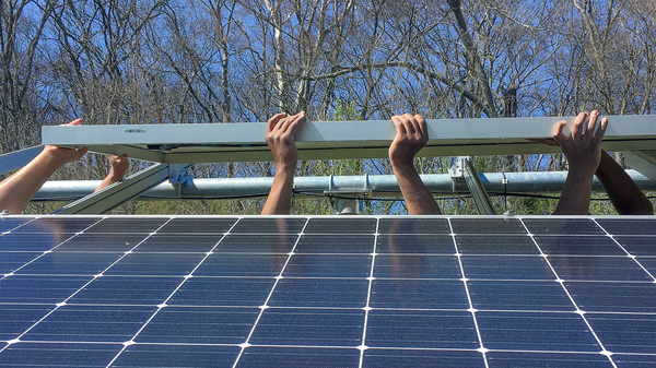 The 40-panel solar installation at Whites Creek High School in north Nashville was paid for by grants and donations and designed and built largely by students under Carney's supervision.