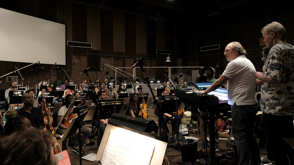 Hans Zimmer, Matt Jones of the Re-Collective Orchestra and conductor Nick Glennie-Smith at a scoring session for Disney