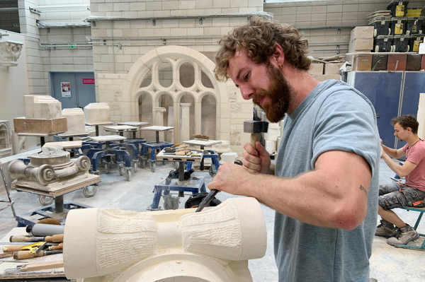 """François Menut works on the base of a Corinthian column. """"With stone carving, we give life to an edifice and perpetuate history. We're also creating a link with the past and transmitting values that are important to conserve in society,"""" he says."""