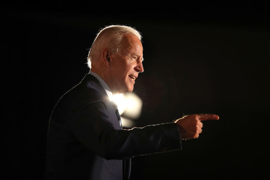 """Opponents running to Joe Biden's left say his health plan for America merely """"tinkers around the edges"""" of the Affordable Care Act. But a close read reveals some initiatives in Biden's plan that are so expansive they might have trouble passing even a Congress held by Democrats. (Justin Sullivan/Getty Images)"""