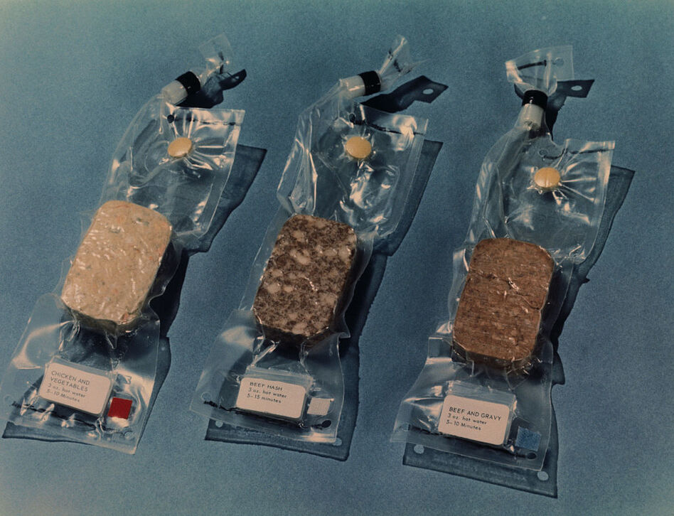Some of the space food that was scheduled to be carried on the Apollo 11 lunar landing mission included (from left to right): chicken and vegetables, beef hash, and beef and gravy. (Bettmann/Bettmann Archive)