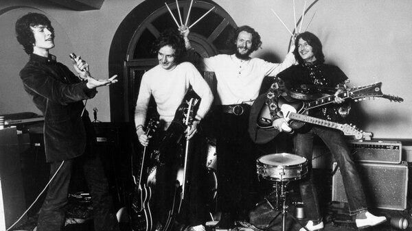 """Rock band """"Blind Faith"""" pose for a portrait in 1969. (L-R): Steve Winwood, Ric Grech, Ginger Baker, Eric Clapton."""