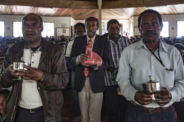 Coca-Cola is part of a spiritual offering, replacing sugar cane, at the Sunday service at Sagurap Catholic Church in the village of Wabag, in Papua New Guinea's Enga Province.