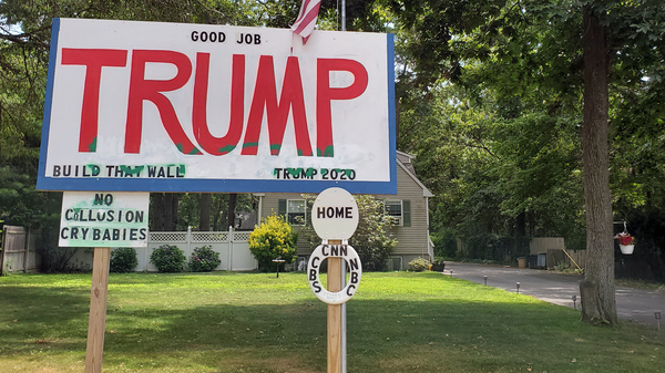 A pro-Trump sign next to B